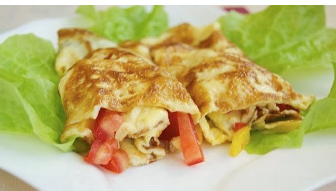 омлет1290629620_omlet-s-pomidorami-percem-i-syrom